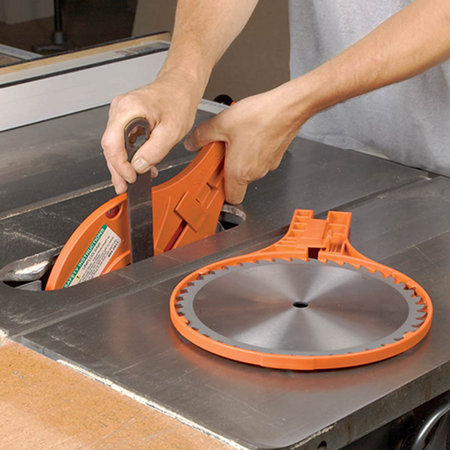Change blades safely with the saw jaw toolmonger ever nicked your hand changing the blade in your table saw the saw jaw may be just the safety accessory for you changing a table saw blade involves using greentooth Gallery