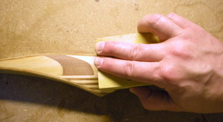 Switch to a foam sanding block and step up the grit to 100, then 150.